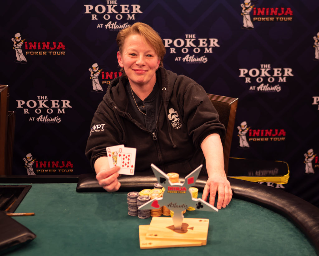 Christine Prichard poses with her trophy after winning an iNinja Poker tour trophy at Atlantis casino.